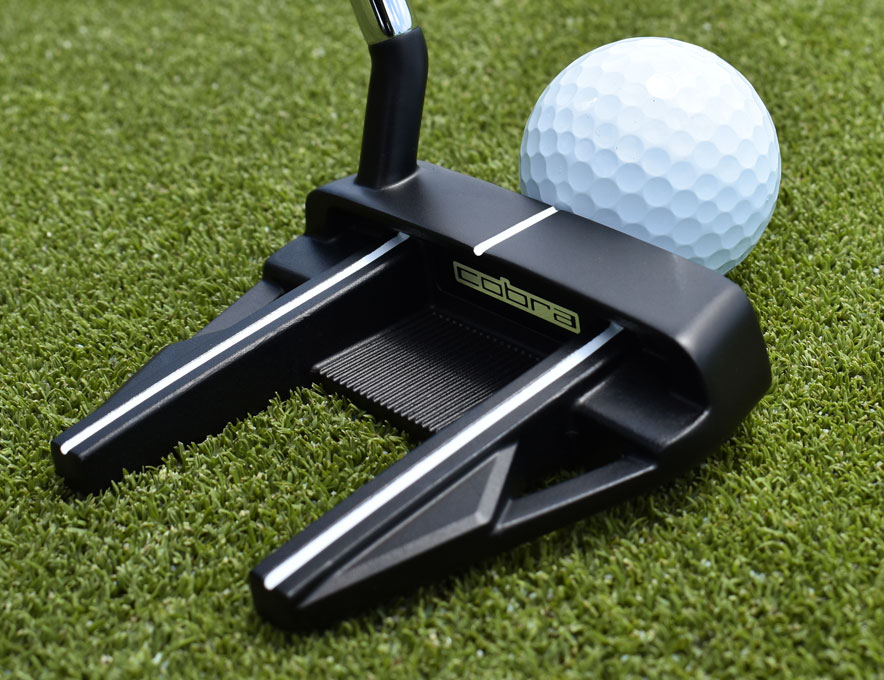 Putter lined up with ball